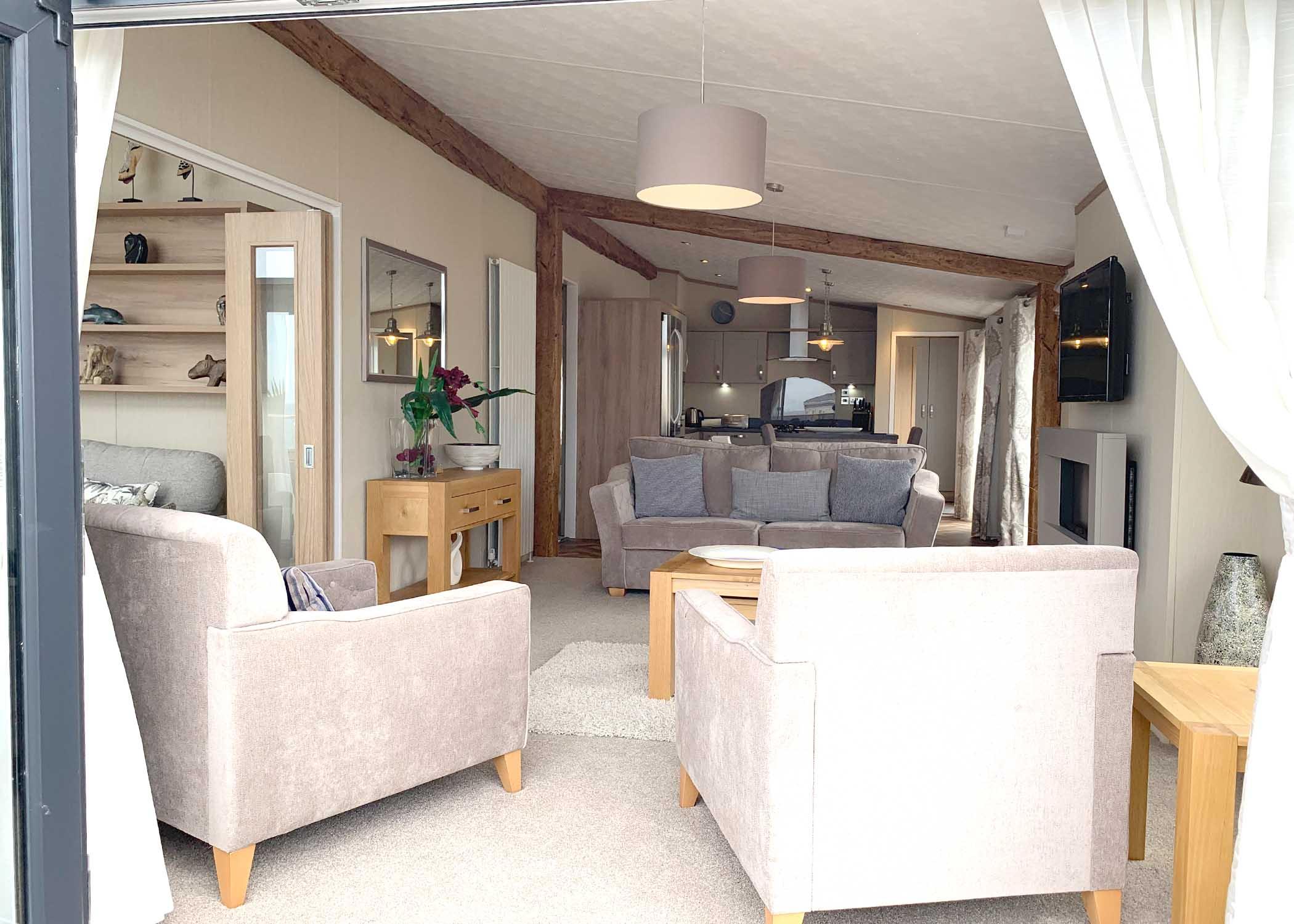 Rivendale Lodge Lounge from patio doors Gwalia Falls Retreat Tresaith Beach